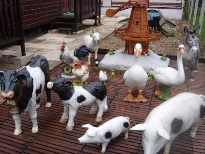 A farmyard scene straight out of Pimp My Static Caravan's Front Yard.