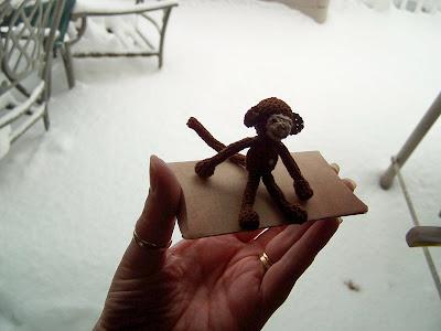 crocheted miniature sock monkey