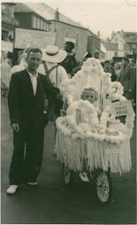 Carnival, St. Ives [Little girl on bicycle float]—B & W, Percy Smith. Dated 1950.