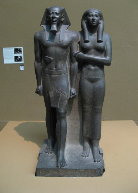 an analysis of sculpture group of king menkaure and his queen