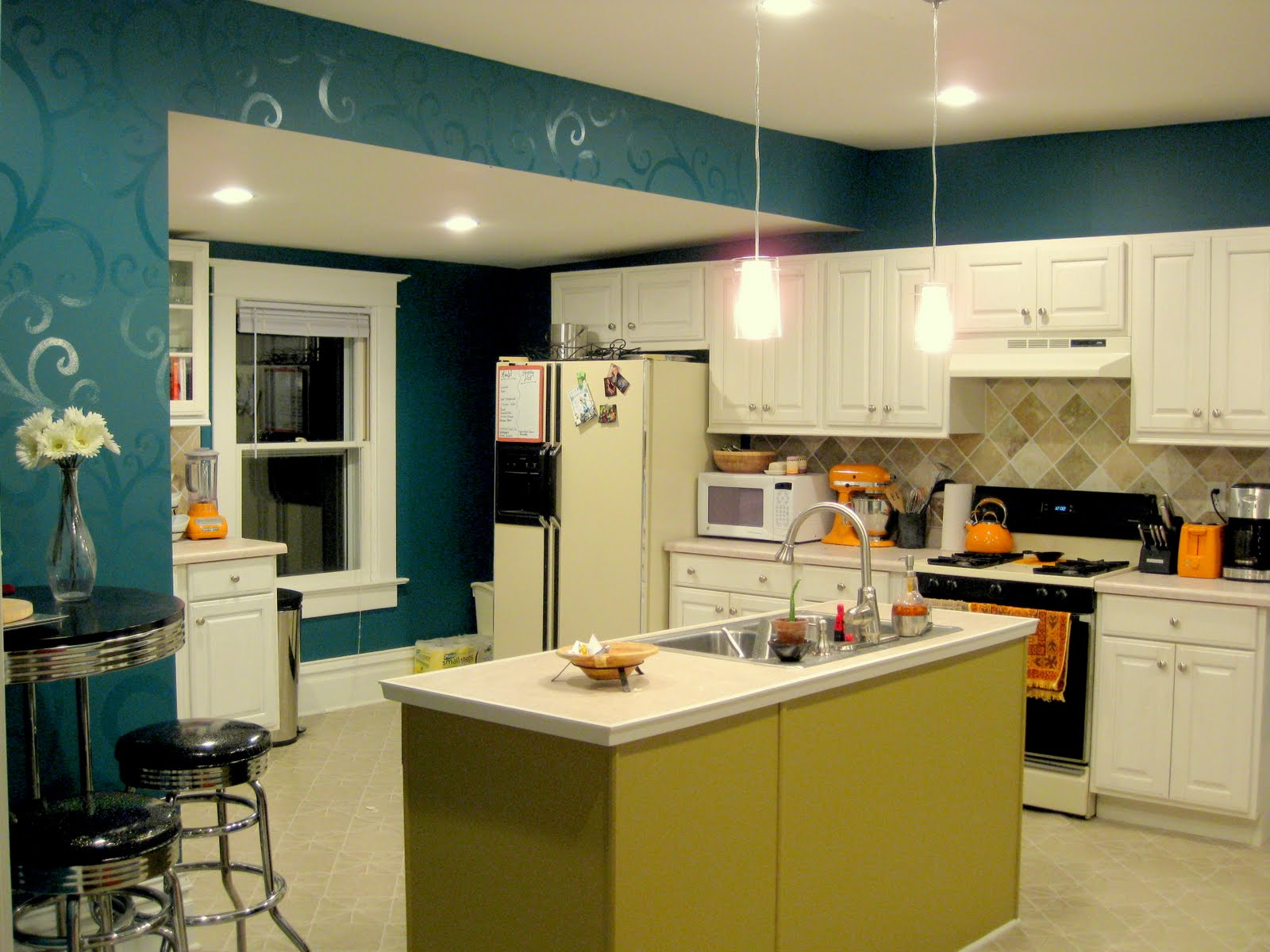 our kitchen reveal kitchen painting ideas Budget Kitchen Updates Accent Wall and Faux Painted Backsplash