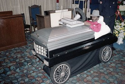 Dead man in his cadillac coffin car