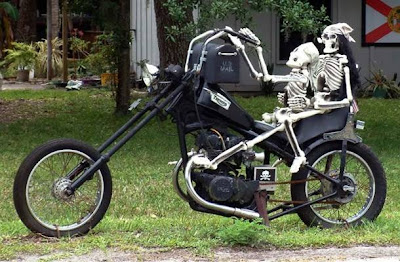 Two Skeletons Riding a Motorycle Mailbox