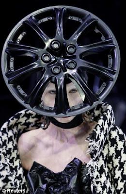 Model wearing a car rim hat at Paris Fashion Week