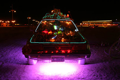 The Vehicle of Enlightenment art car at night by Susan Jette