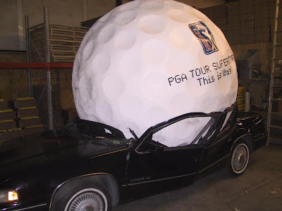 One giant golf ball crushed car or is Tiger Wood's career getting crushed under the weight of his giant ego?