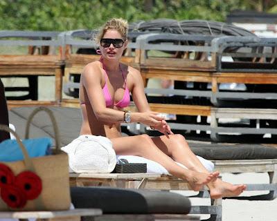 Doutzen Kroes in a pink bikini