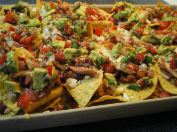 nachos. Layered tortilla chips, grated Jack cheese, shredded chicken ...