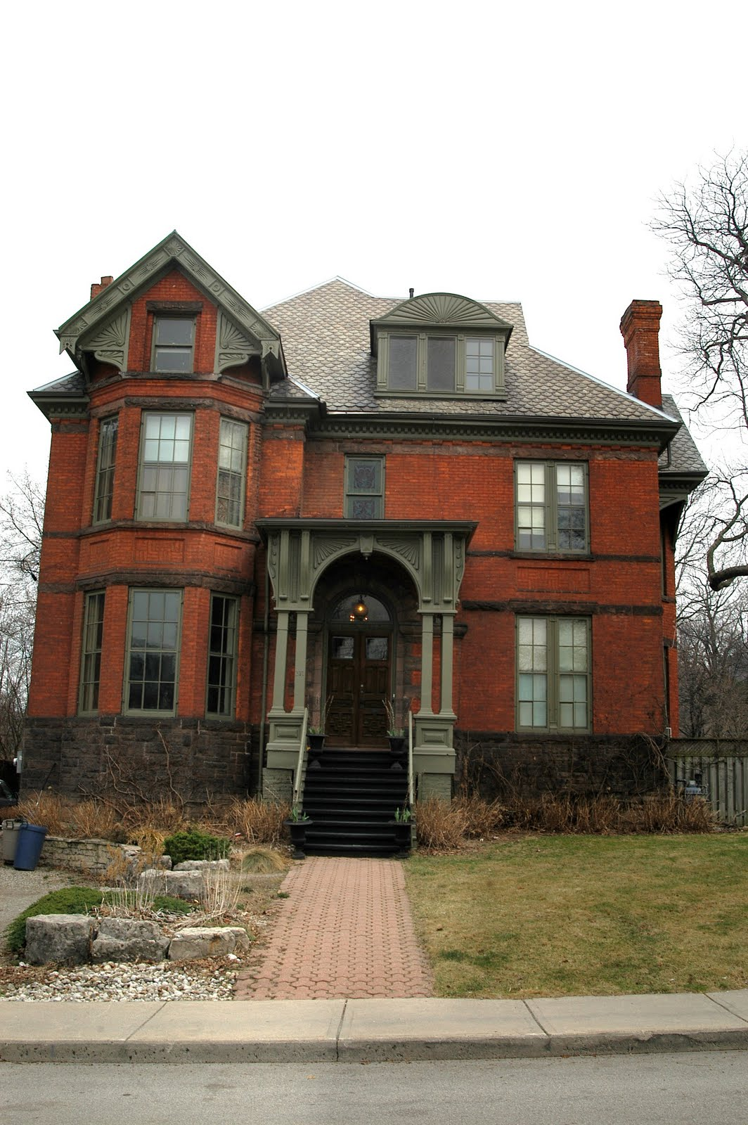 A daily victorian red brick queen anne hamilton ontario for Brick victorian house