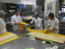 Rolling out a 20 foot sheet of Pasta