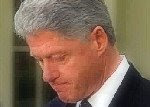 Bill Clinton hangs head in contemplation of answer
