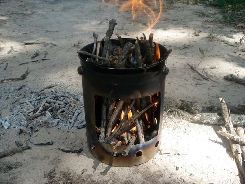 Cooking with Candles on a Tin Can Stove - A research center