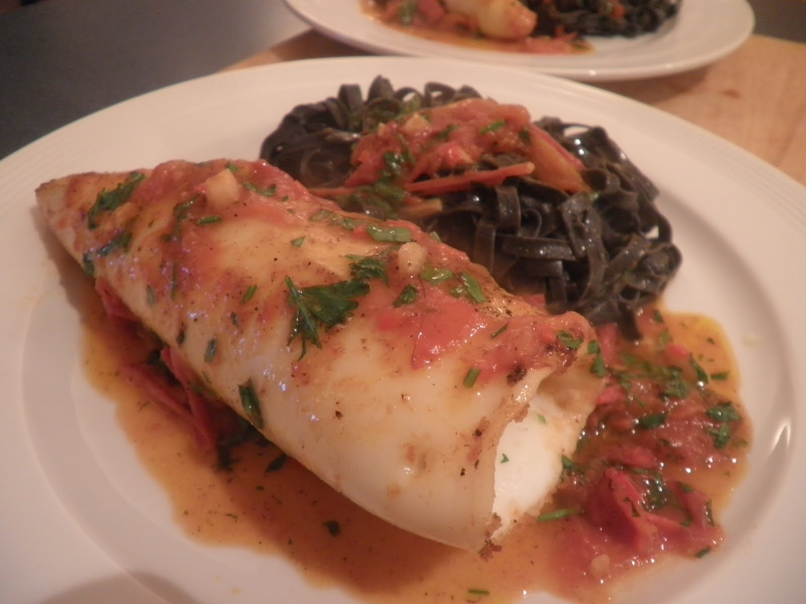 ... Squid stuffed with breadcrumbs, garlic and parsley, Squid ink pasta