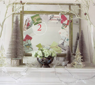 Christmas cards tucked along mirror frame