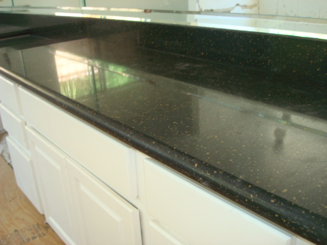 Antigua marble granite silestone caesarstone in los for Caesarstone cost per slab