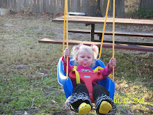 Mema pushing Bree in her swing at their house.