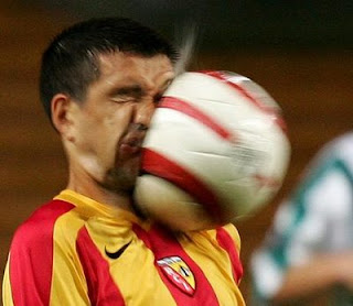 funny football photos ball hits face