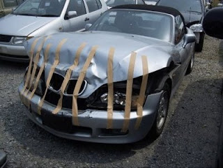 funny smashed car photo bmw held together with tape