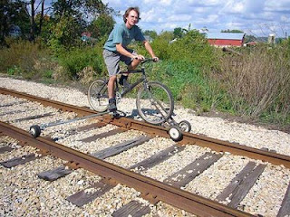 funny train photo of bike on rail lines new invention