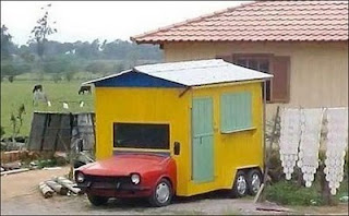 funny photo of car made as a house like a caravan