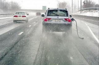 really funny stupid photo of driver in bmw who hasnt disconnected the gas pump hose and drives down the highway with it still in tank
