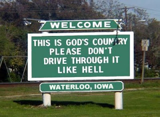funny road signs from waterloo iowa god's country dont speed like you are going through hell photo
