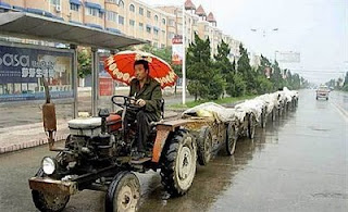 funny photos of really long road train in asia in rain