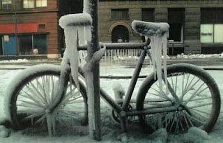 funny photo of bike left out in the cold got frozen and icy