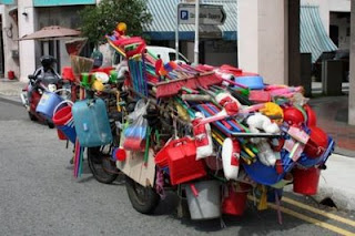 funny photos street sweeper cart or salesman overloaded with brooms buckets and pans