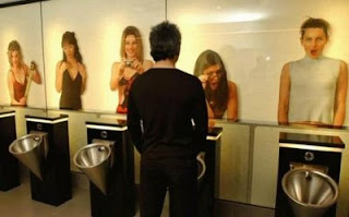 funny photo of toilet art at mens urinal