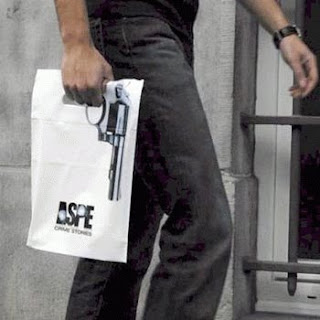 funny photo of bag that is in shape of a gun aspe crime stories
