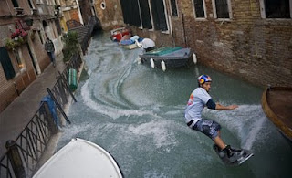 funny venice photo of guy on waterski riding through the canals past the gondolas