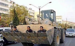 funny photos ride to work day in front of bulldozer