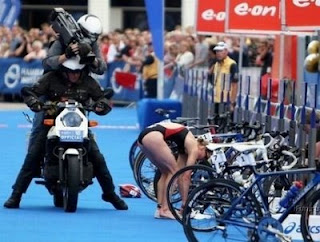 funny photos of voyeur camera crew filming girl from behind at triathlon