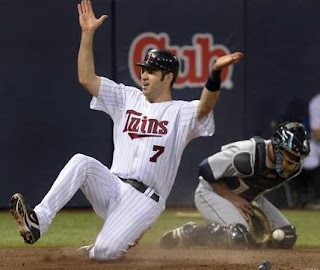Joe Mauer Sliding into the plate