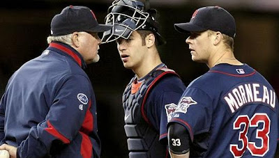 Joe Mauer and Justin Morneau talking to the Minnesota Twins Coaching Staff