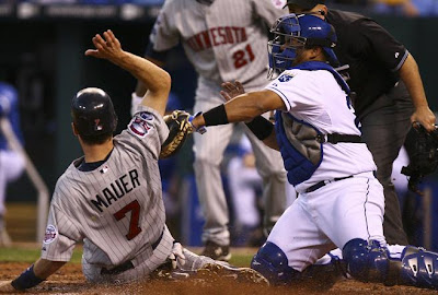 Twins Royals game, Joe Mauer sliding into home