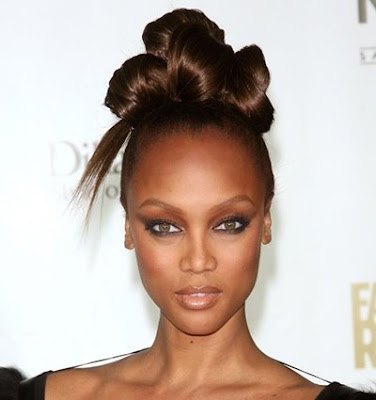 Tyra Banks Hairstyles Tyra Banks with sophisticated multi-layered bun updos.