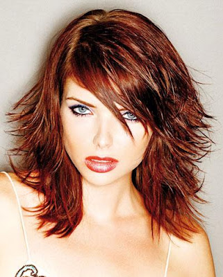 layered hairstyles for straight hair. This picture shows off a young girl with a great shoulder length hair style.