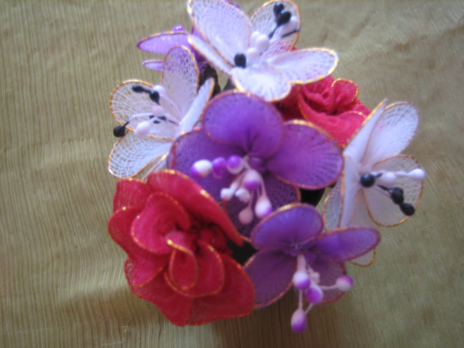 ... of stocking cloth and prepared 3 types of flowers and arranged it