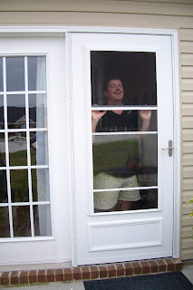 Formerly itinerant roadie the storm door and a patio tour for Storm door with roll up screen