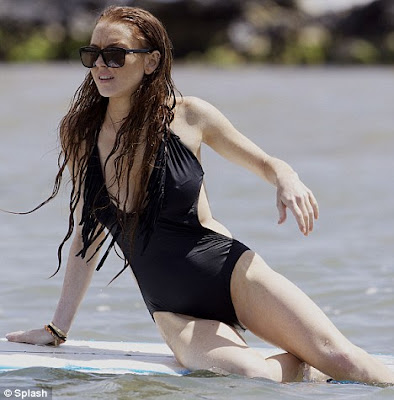 Lindsay Lohan Soaks Up Sun In Hawaii In Black Bikini