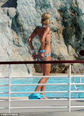 Paris Hilton Poses In Sexy Bikini at Pool Side in Cannes