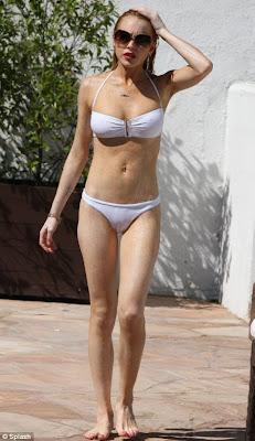 Lindsay Lohan Sizzles In Sexy White Bikini