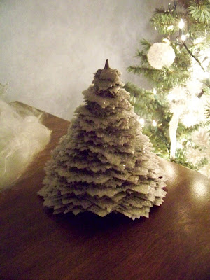 My four girls newspaper christmas tree for What to put on top of my christmas tree