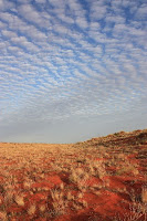 sunset over a valley of Arunta -Simpson desert's aboriginal name-