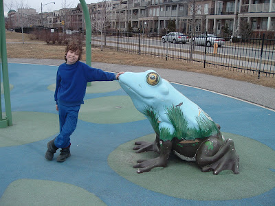 [Photo: Nicky poses with frog at Woodbine Park.]