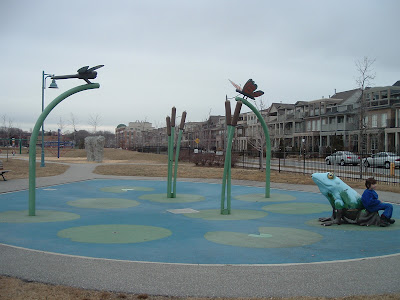 [Photo: marsh-themed splashpad at Woodbine Park.]