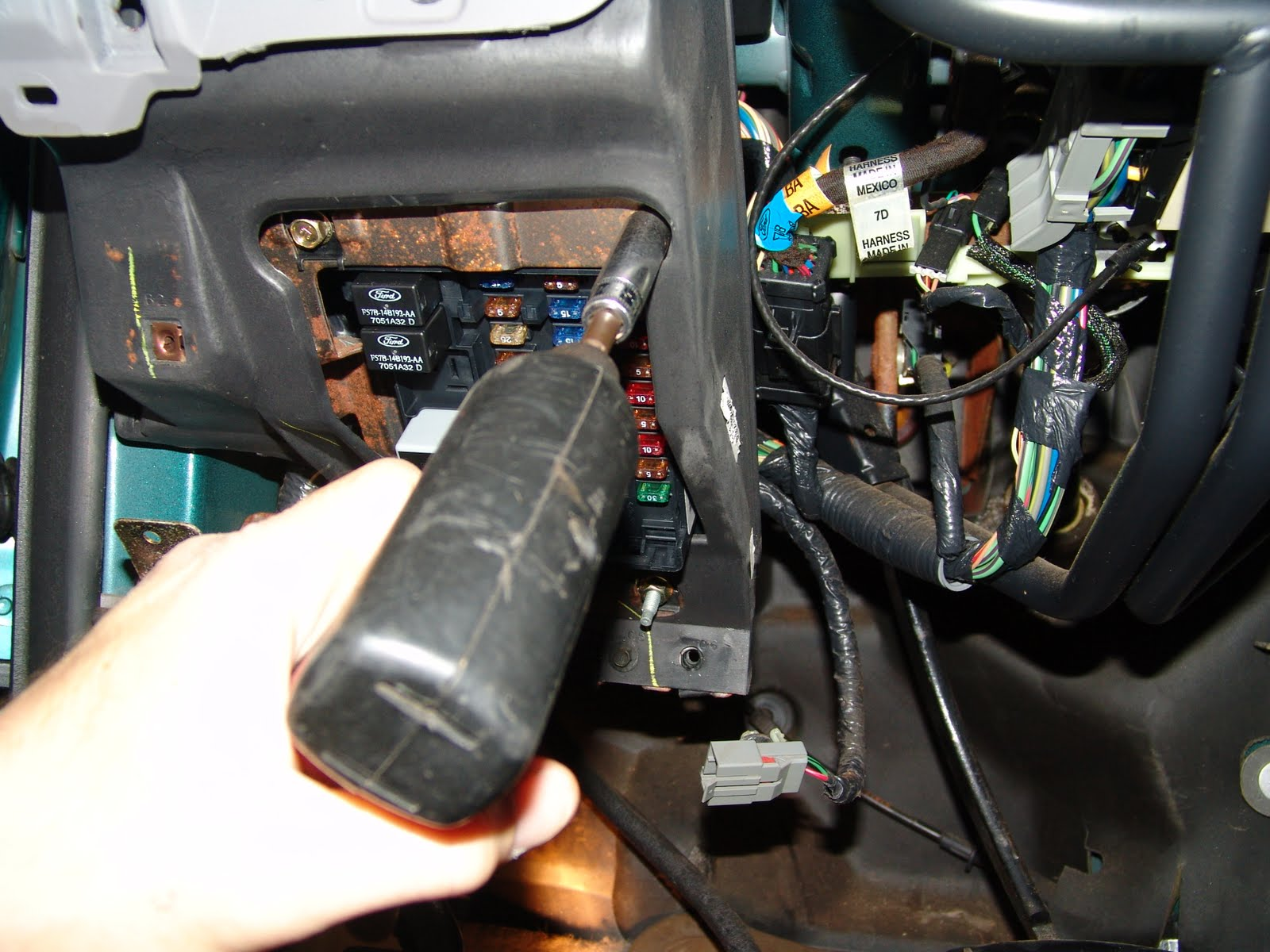The wiring harnesses can be removed from the back of the fuse box. Two