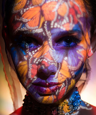 face painted with butterflies, butterfly